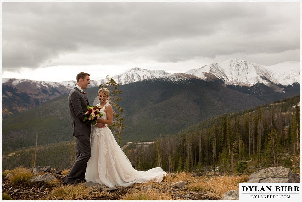 the lodge at sunspot wedding winter park couple on top of mountain