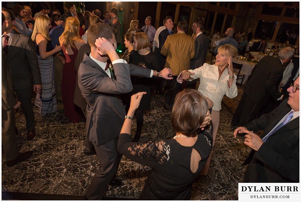 the lodge at sunspot wedding fall mountain wedding winter park reception party groom dancing with mom