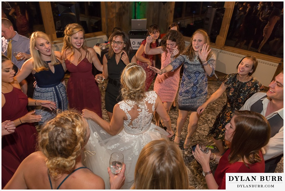 the lodge at sunspot wedding fall mountain wedding winter park reception party bride dancing with friends
