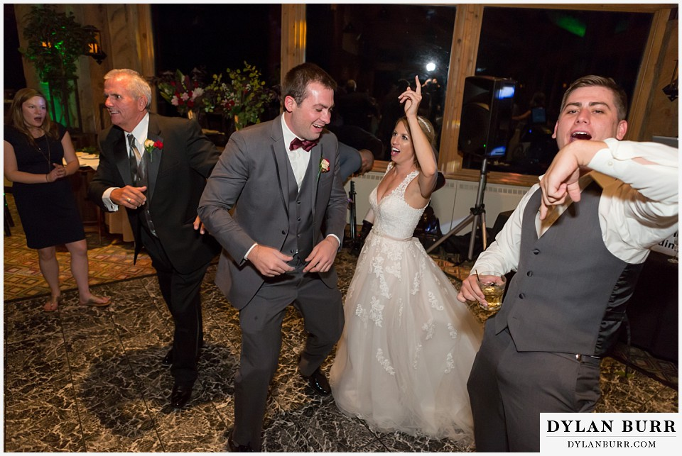 the lodge at sunspot wedding fall mountain wedding winter park reception party bride dancing with brothers