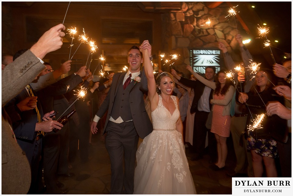 the lodge at sunspot wedding fall mountain wedding winter park reception party sparkler wedding exit couple