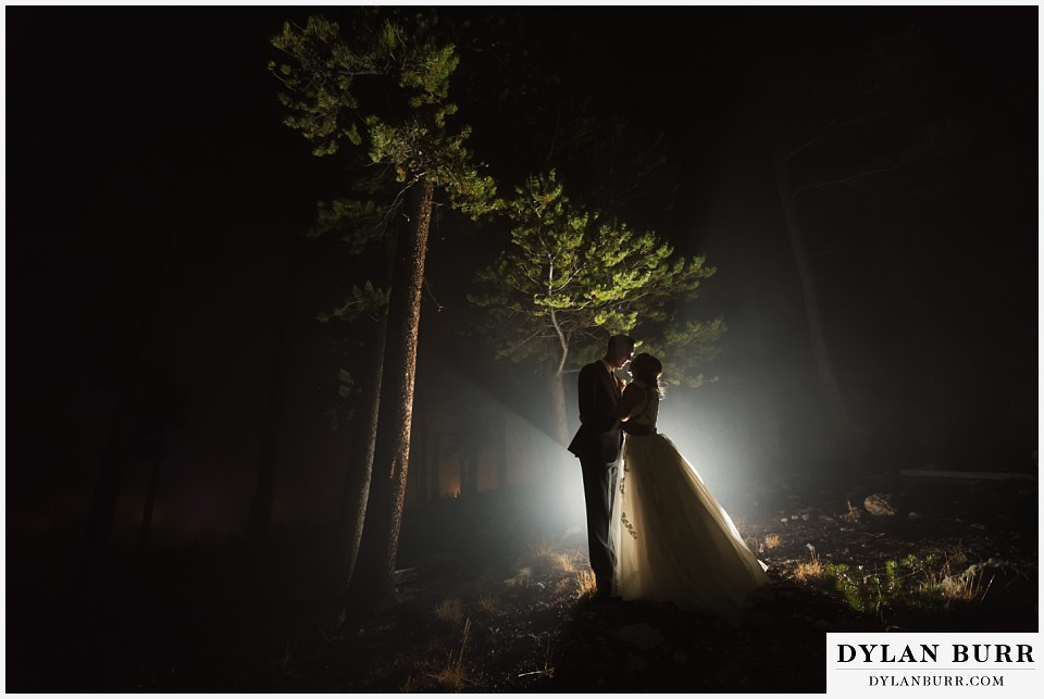 the lodge at sunspot wedding fall mountain wedding winter park couple night portraits in fog