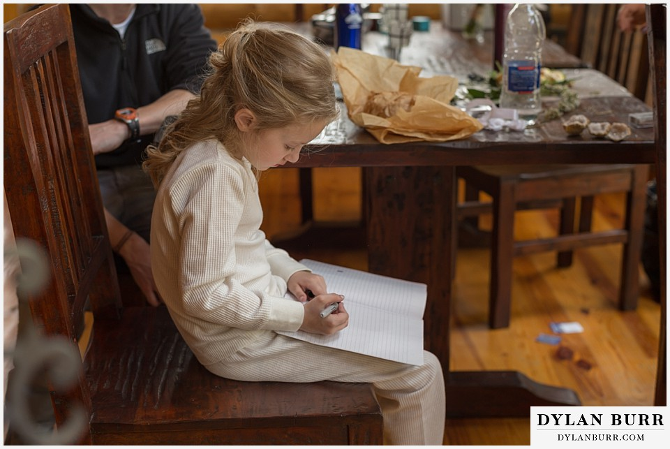 grand teton destination wedding daughter writing note to mom