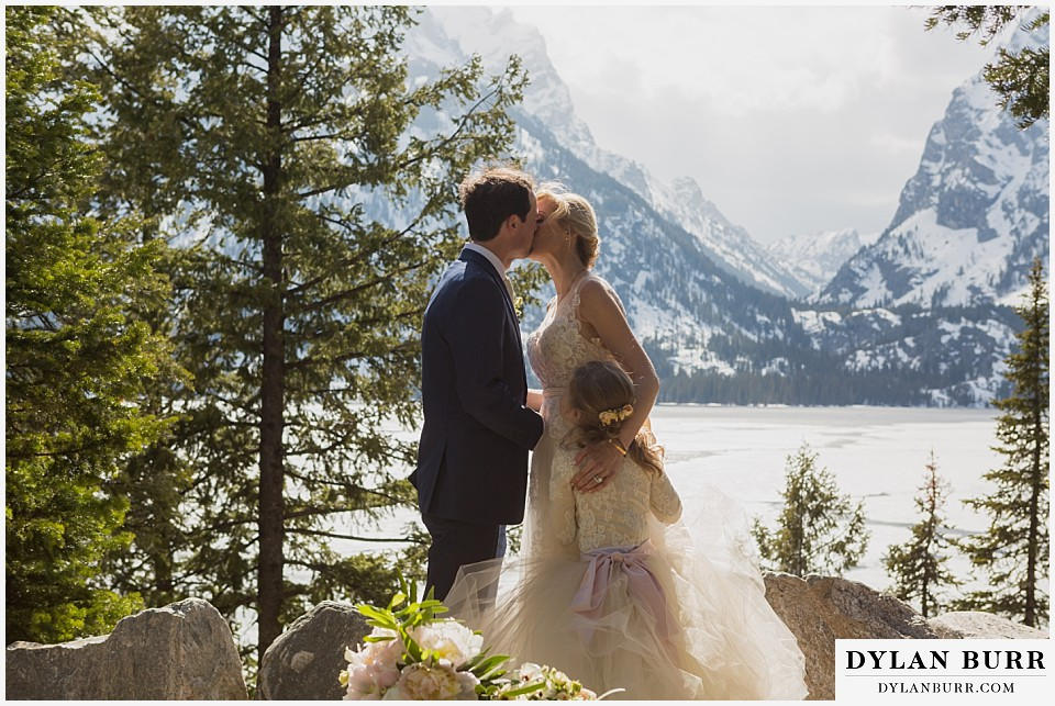 grand teton destination wedding ceremony first kiss