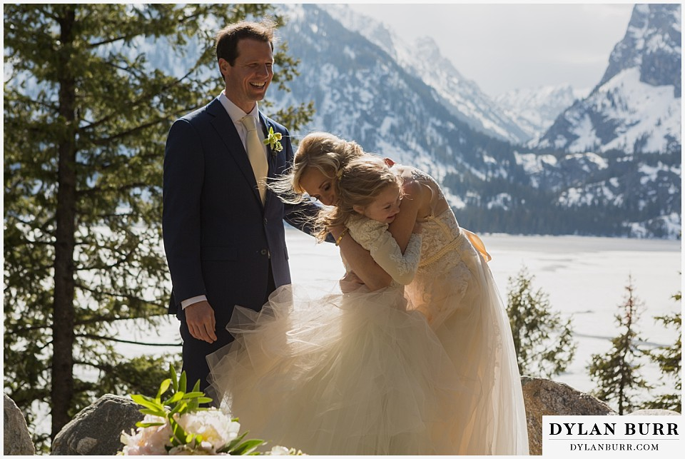 grand teton destination wedding ceremony hugs