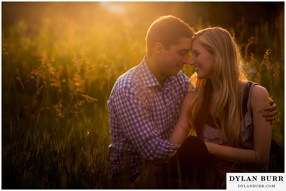 how to prepare for my engagement session couple sitting at sunset