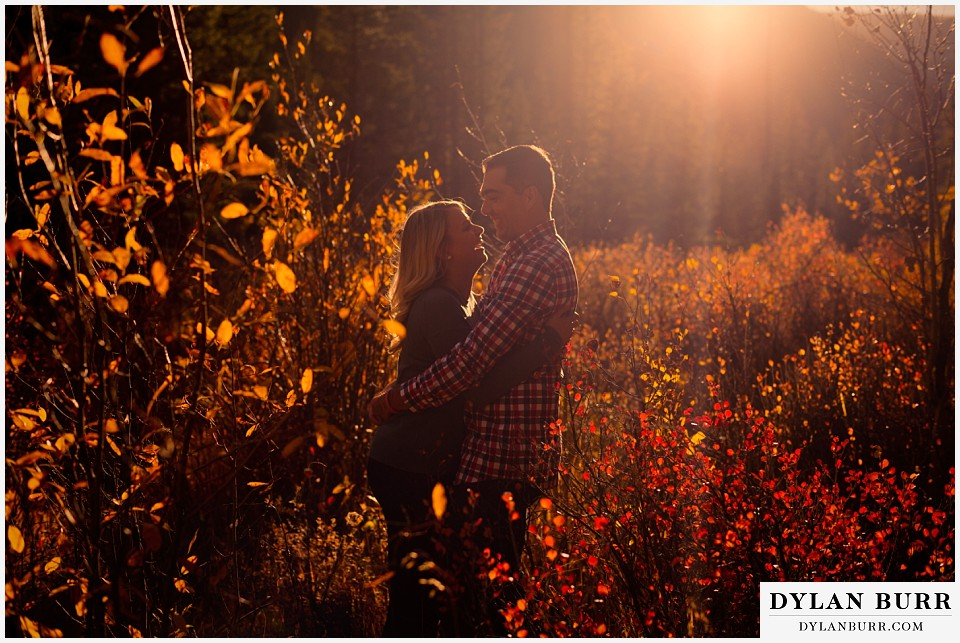 how to prepare for my engagement session couple laughing during sunset