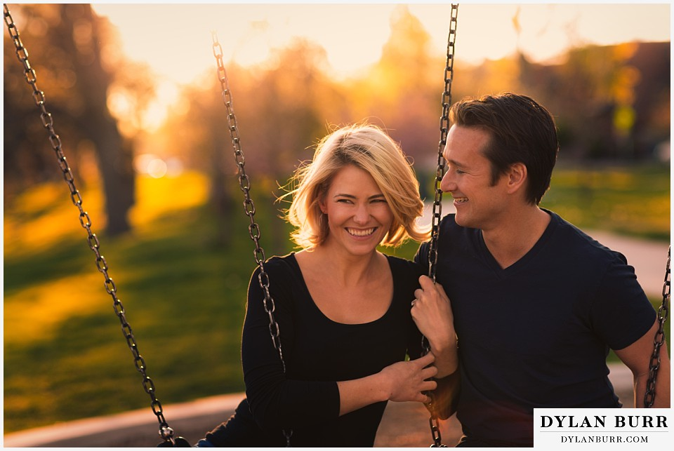how to prepare for my engagement session couple having fun on swings at sunset