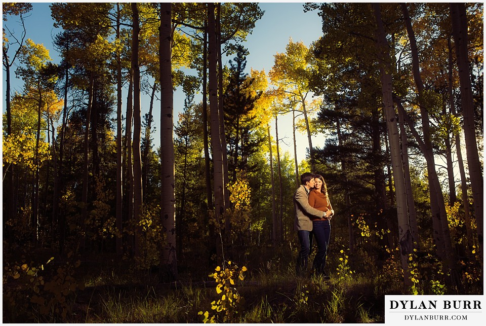 how to prepare for my engagement session couple standing in aspen trees in early fall