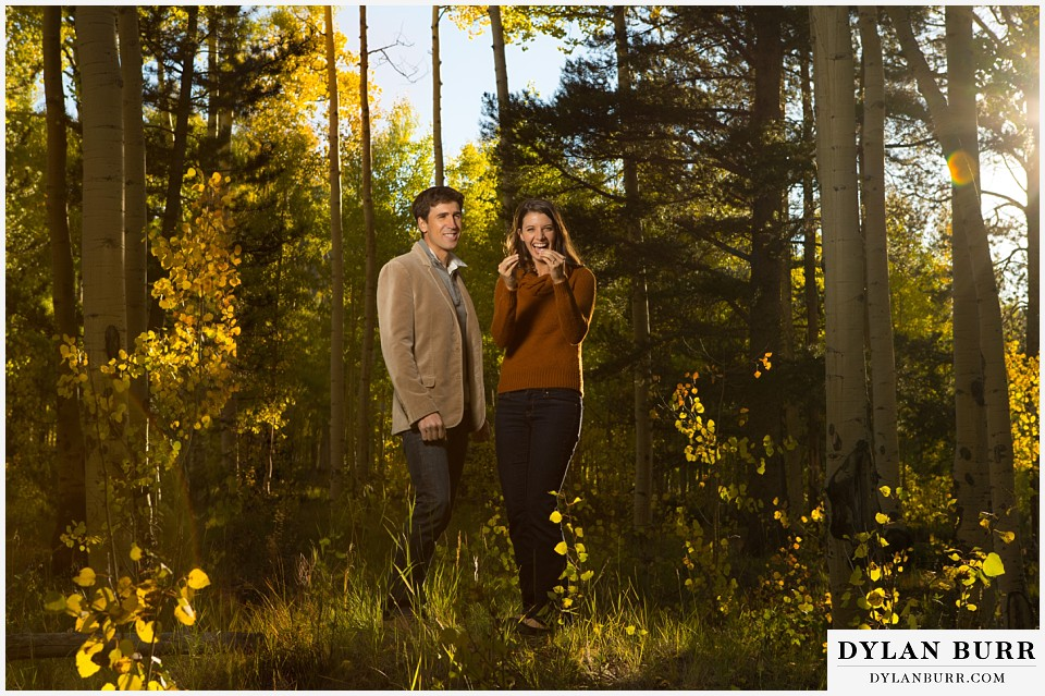 how to prepare for my engagement session couple laughing together in aspen trees