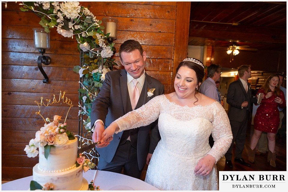crystal rose wedding golden colorado bride and groom cutting cake