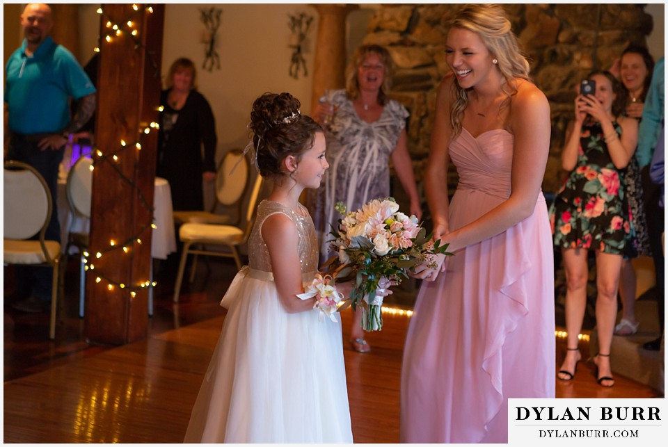 crystal rose wedding golden colorado flower girl catches bouquet