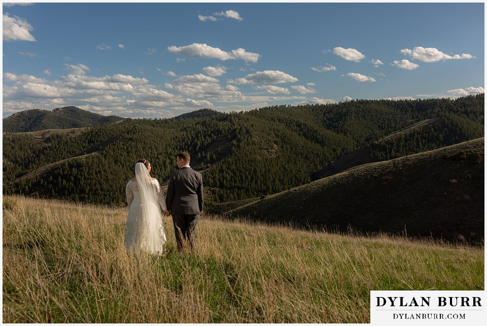mother cabrini shrine wedding golden colorado bride and groom walking in the mountains