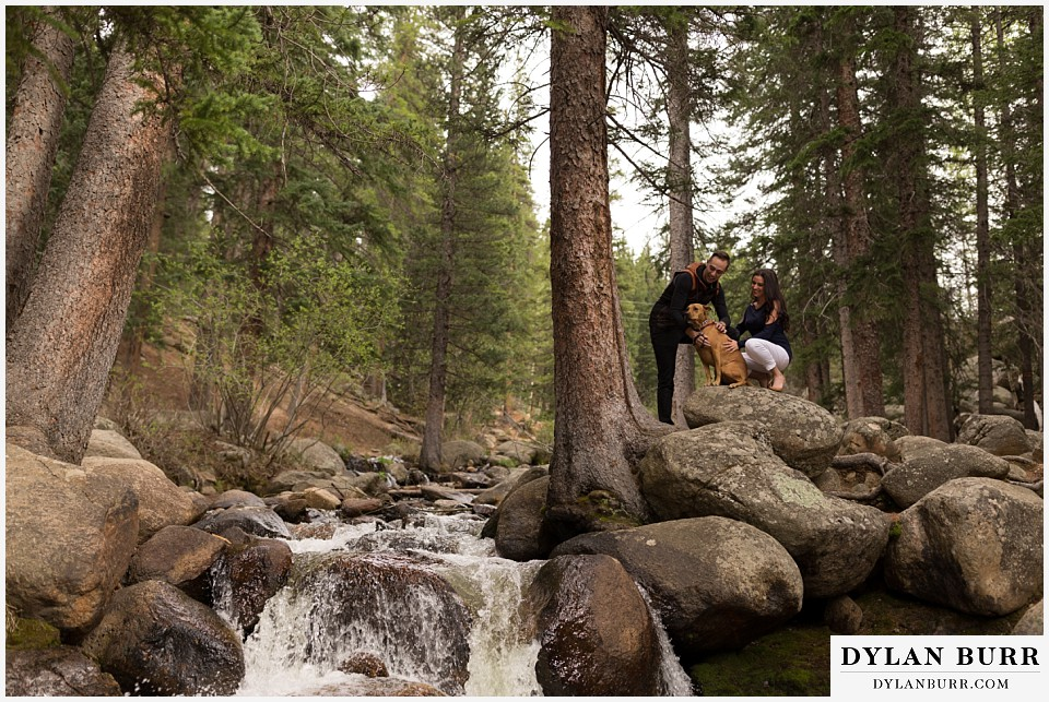 rocky mountain engagement session in colorado river waterfall