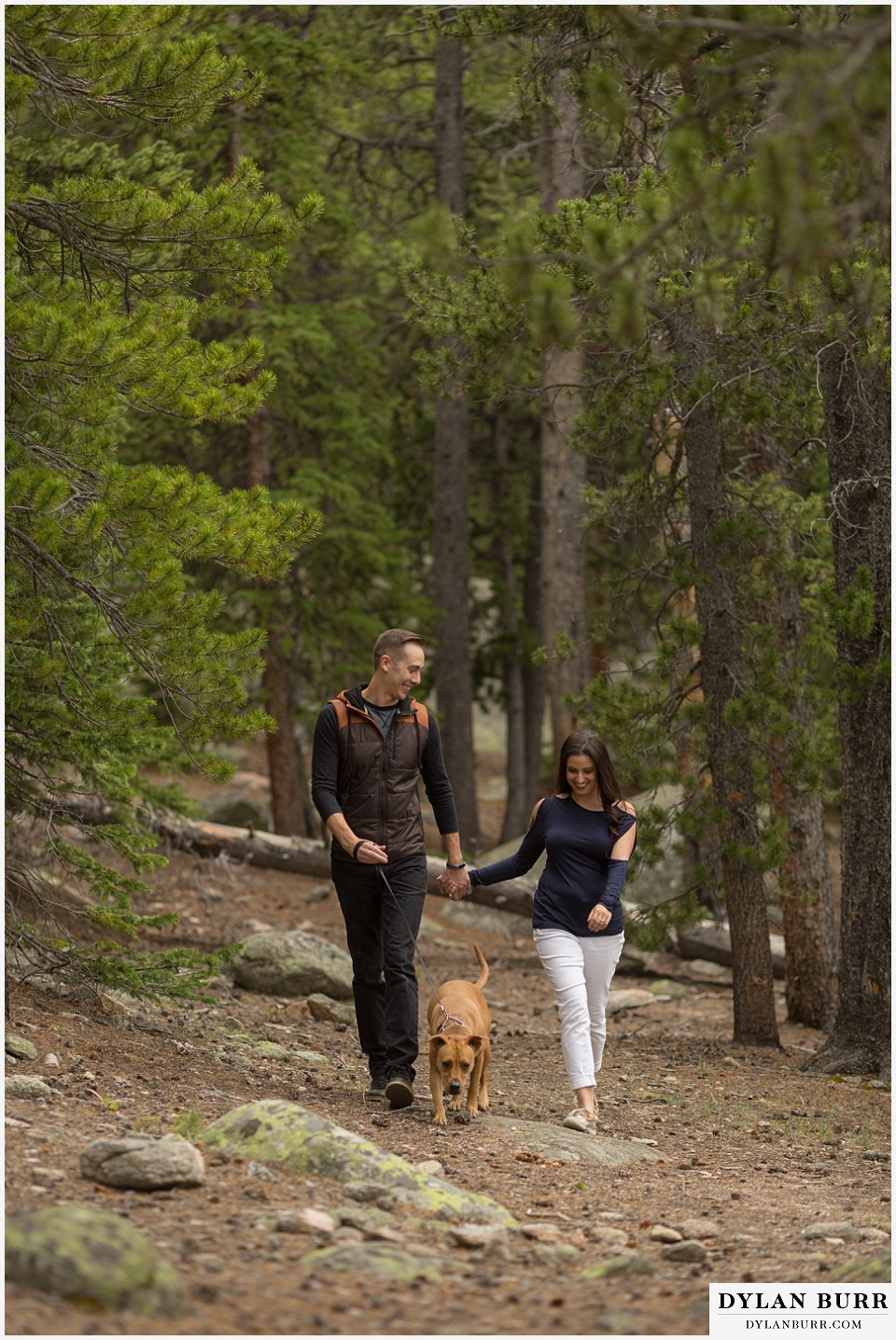 rocky mountain engagement session in colorado walking on trail