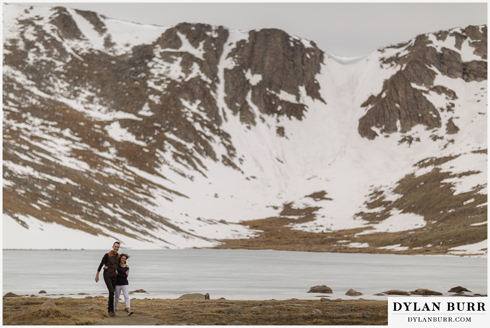 rocky mountain engagement session in colorado snowy mountains and lake