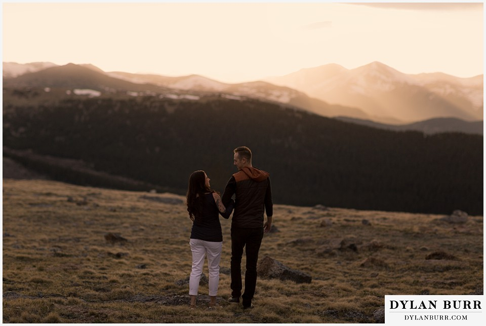 rocky mountain engagement session in colorado sunset cutting through mountains