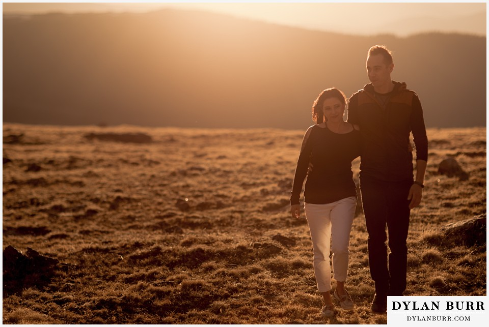 rocky mountain engagement session in colorado walking together in sunset