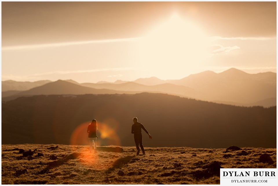 rocky mountain engagement session in colorado playing tag at sunset