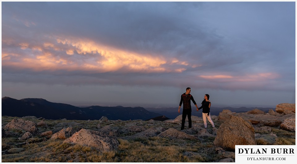 rocky mountain engagement session in colorado sunset panorama hiking in the mountains