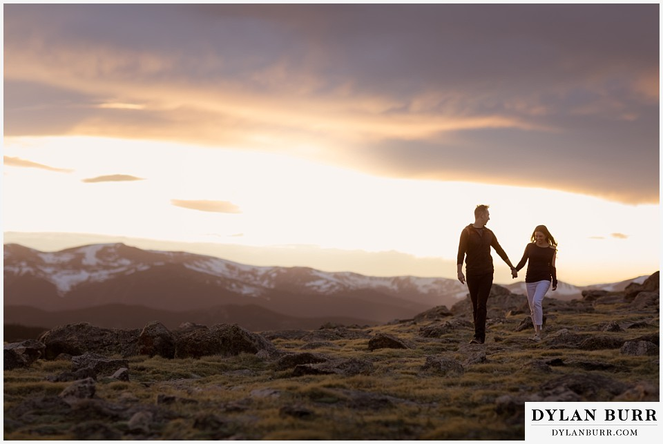 rocky mountain engagement session in colorado alpine trail with snow on top of mountains in background