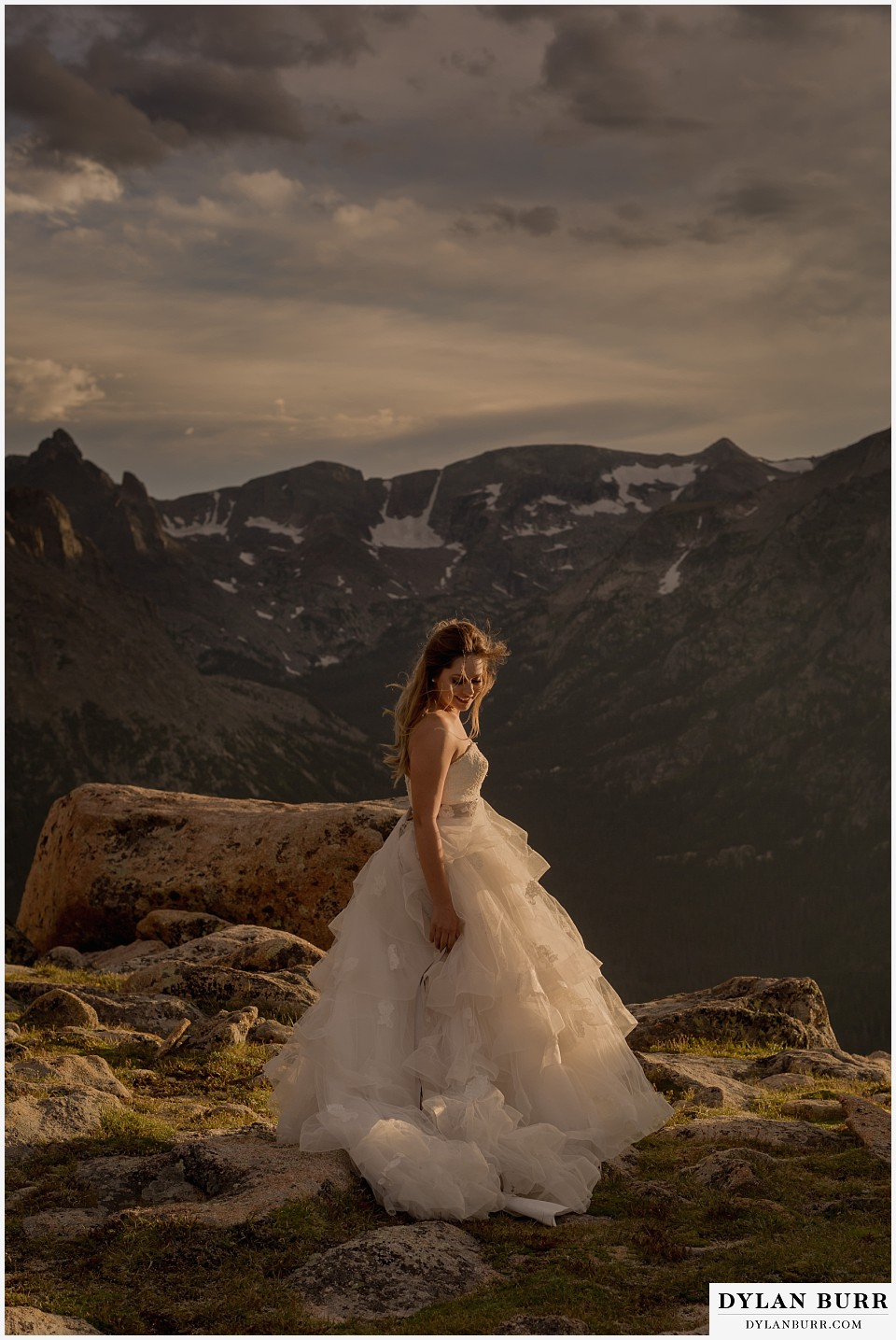 rocky mountain national park elopement adventure wedding bride on mountain top