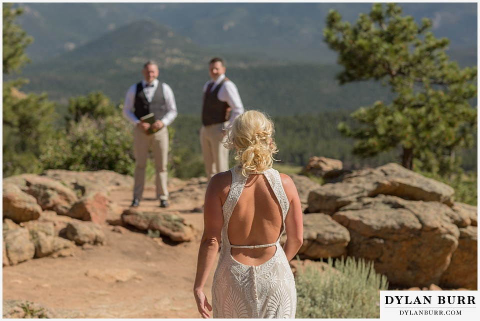 rocky mountain national park wedding elopement groom looks on as the bride approaches