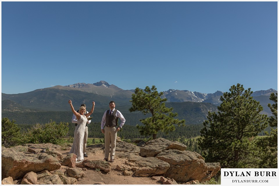 rocky mountain national park wedding elopement bride celebrating in mountains