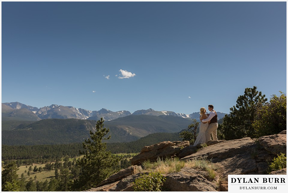 rocky mountain national park wedding elopement bride and groom with huge mountain views