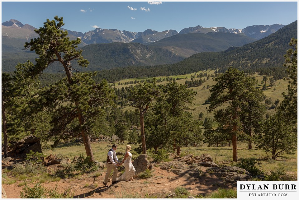 rocky mountain national park wedding elopement bride and groom walking together in the sunny mountains