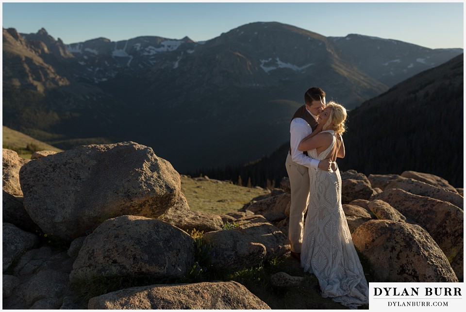 rocky mountain national park wedding elopement bride and groom sharing a mountain top kiss