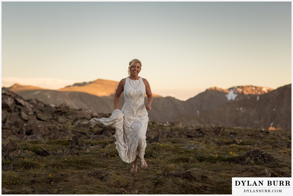 rocky mountain national park wedding elopement bride running on alpine tundra