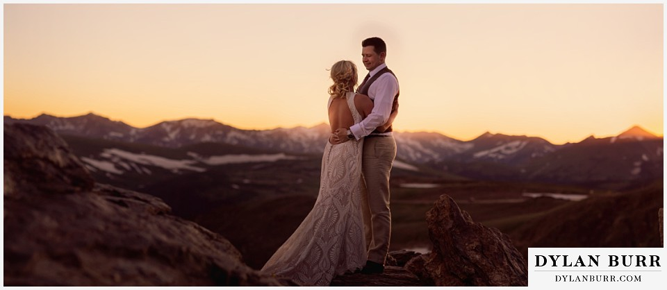 rocky mountain national park wedding elopement bride and groom on mountain top at sunset