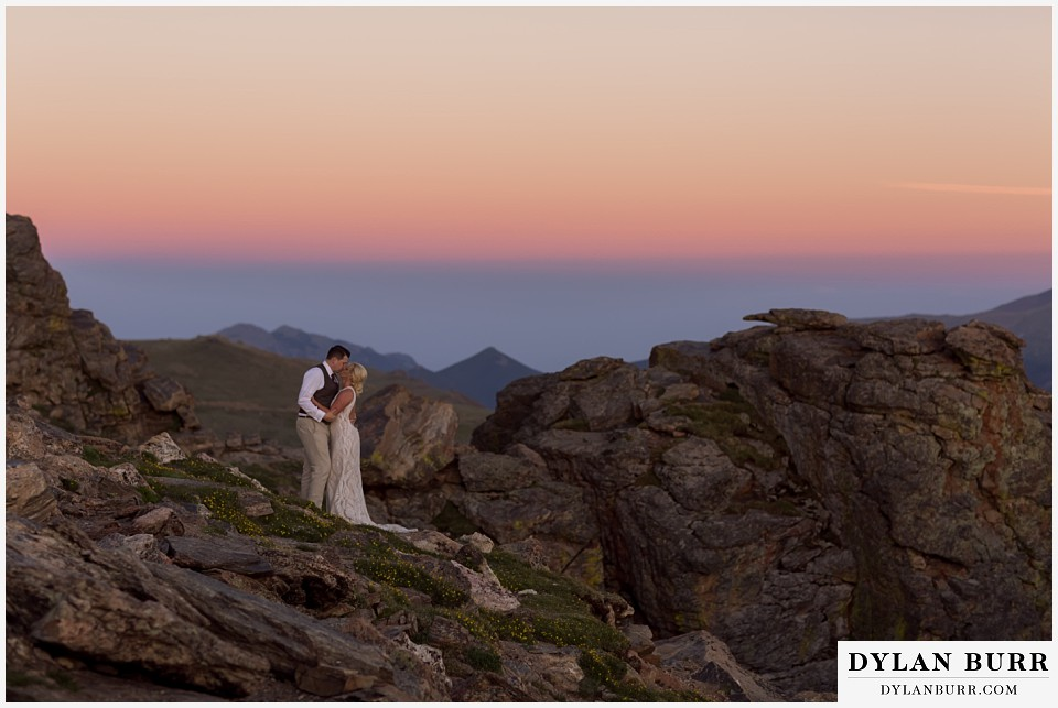 rocky mountain national park wedding elopement bride and groom kissing in rocks
