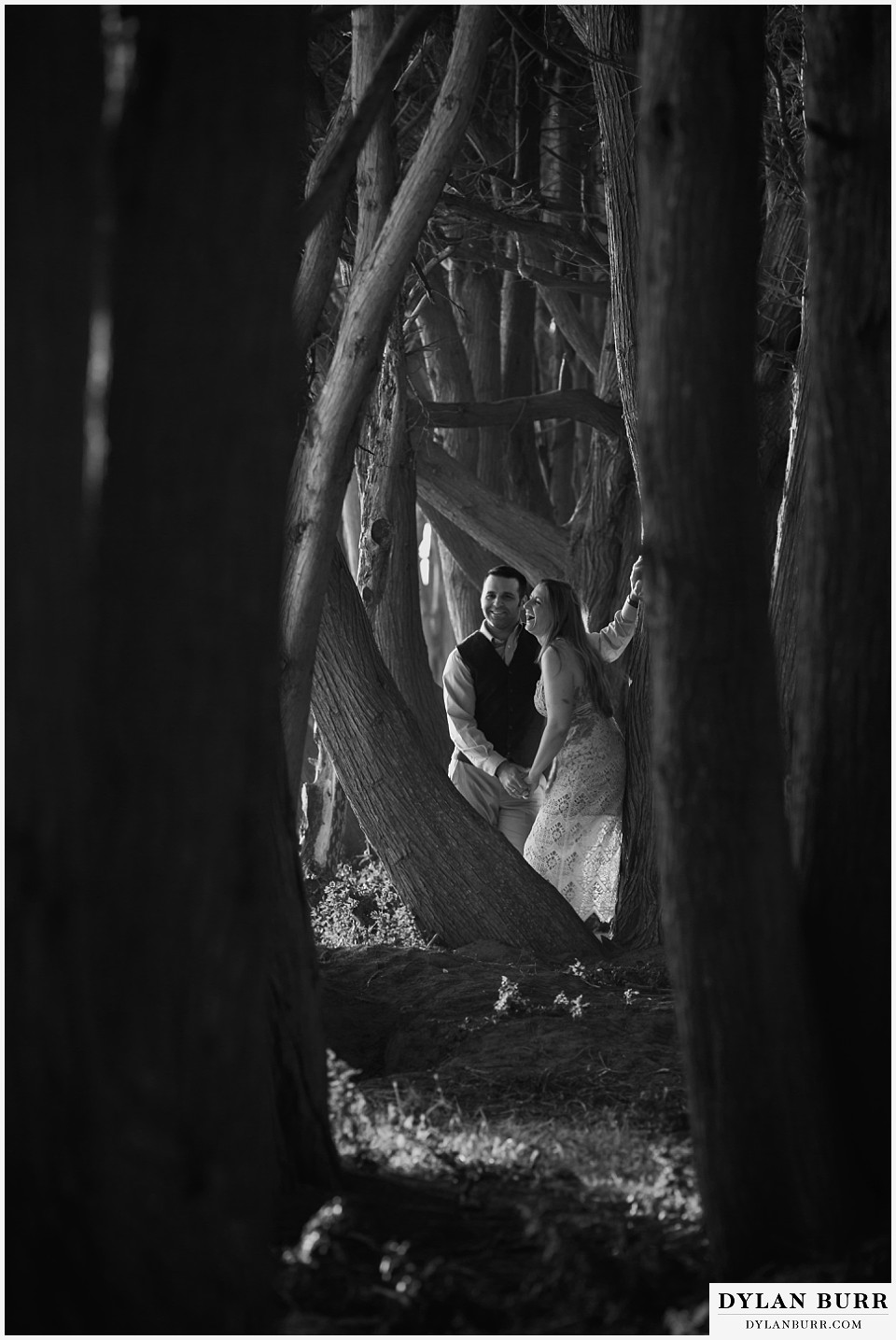 santa cruz california elopement wedding adventure bride and groom in cypress trees laughing together