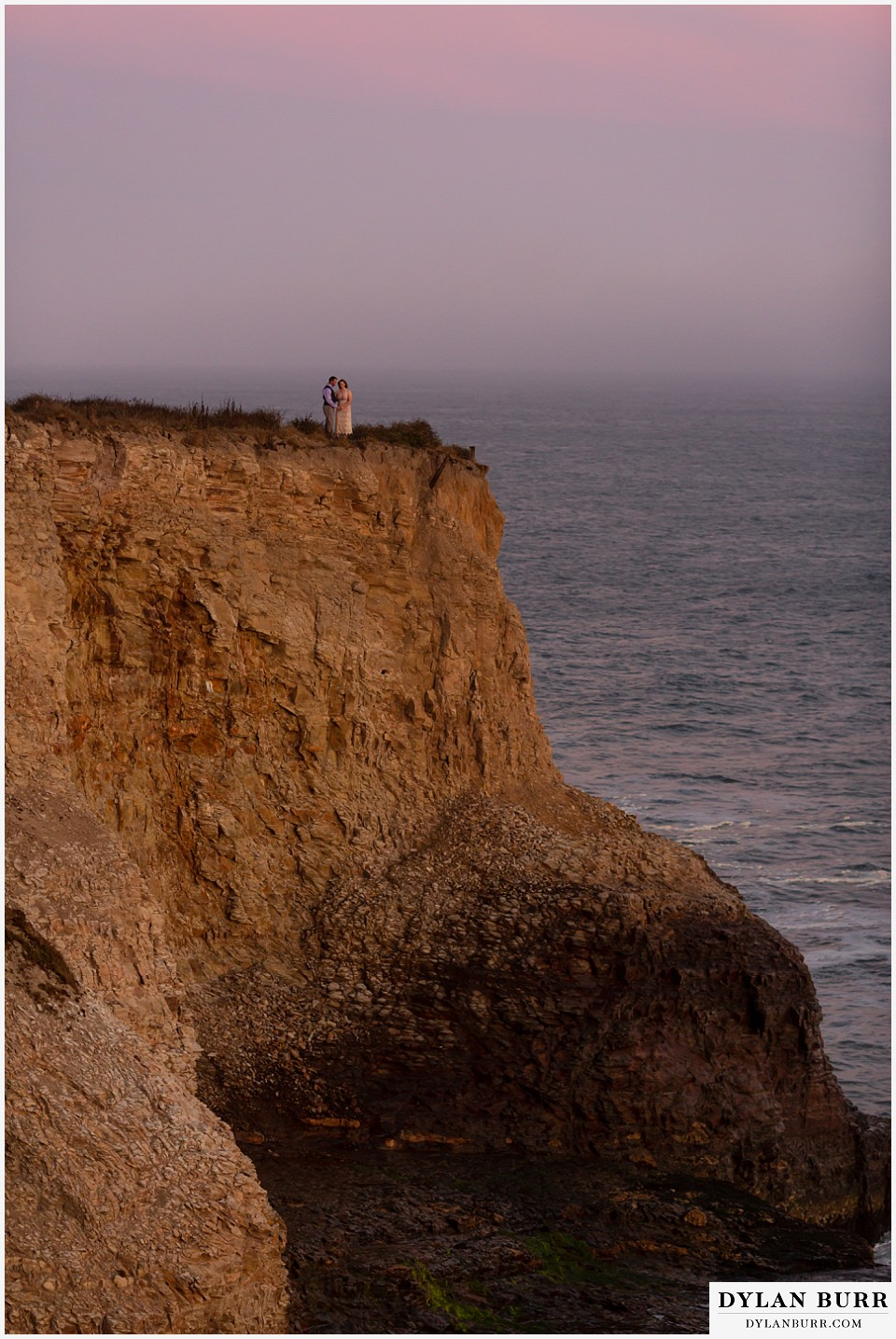 santa cruz california elopement wedding adventure bride and groom on top of cliffs at sunset