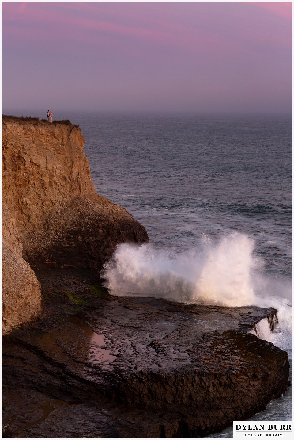 santa cruz california elopement wedding adventure bride and groom on top of cliffs as giant waves roll in