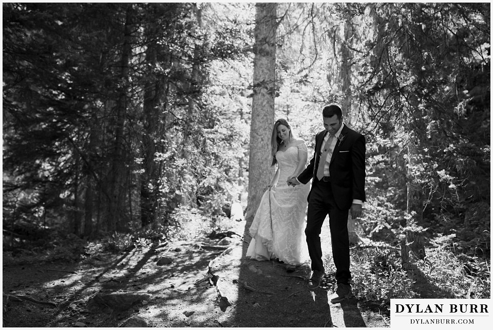 uncompahgre national forest colorado elopement wedding adventure bride and groom walk together through pine trees