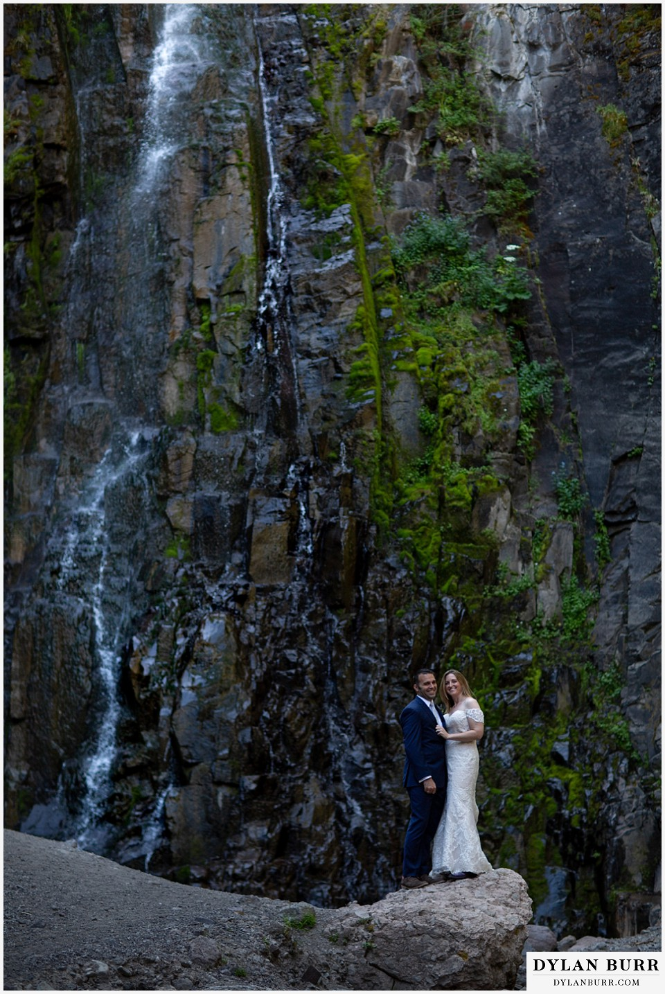 uncompahgre national forest colorado elopement wedding adventure bride and groom together on a rock near a waterfall