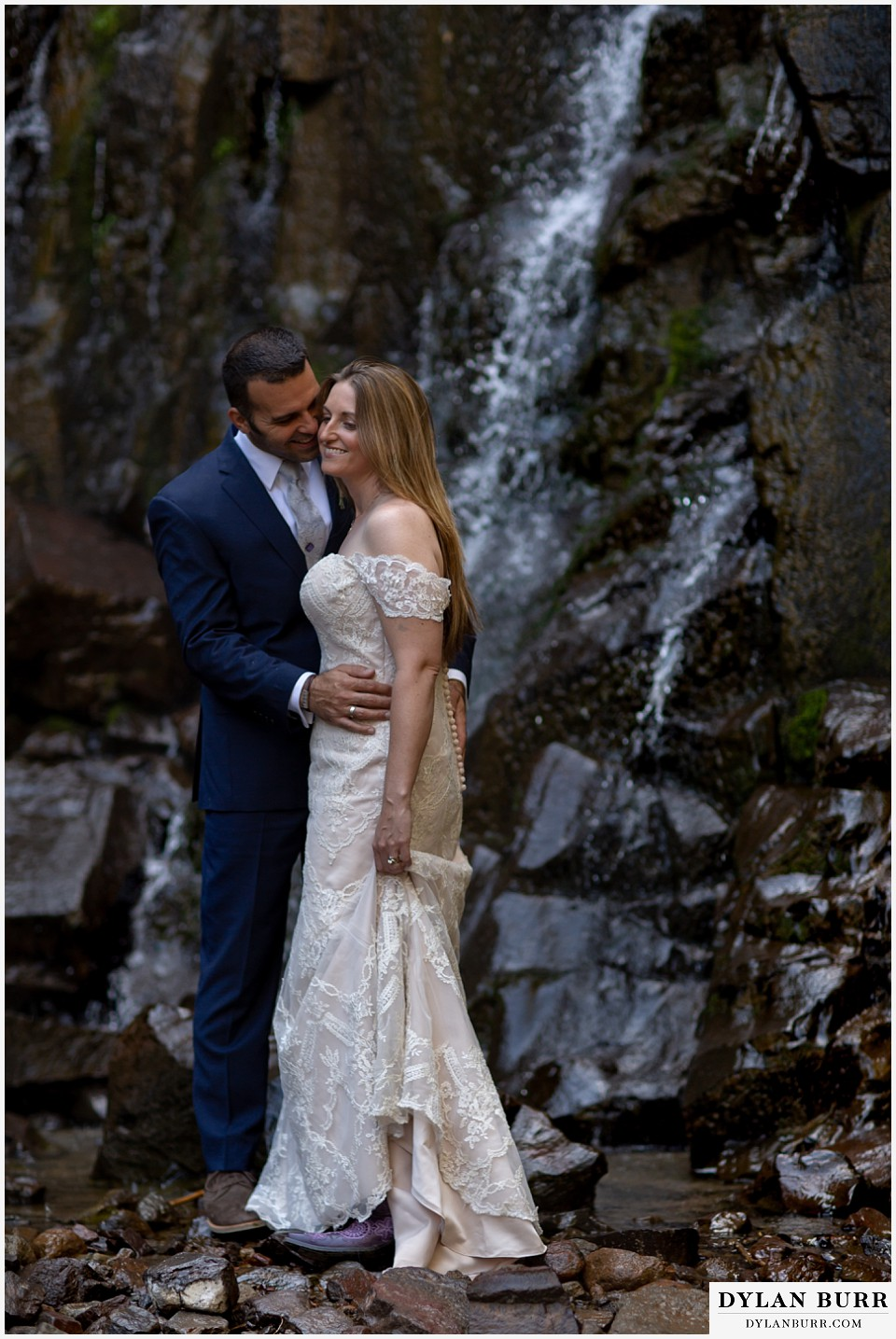 uncompahgre national forest colorado elopement wedding adventure bride and groom kissing at waterfall