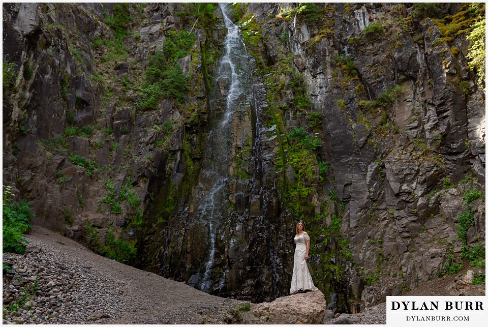 uncompahgre national forest colorado elopement wedding adventure bride alone at waterfall