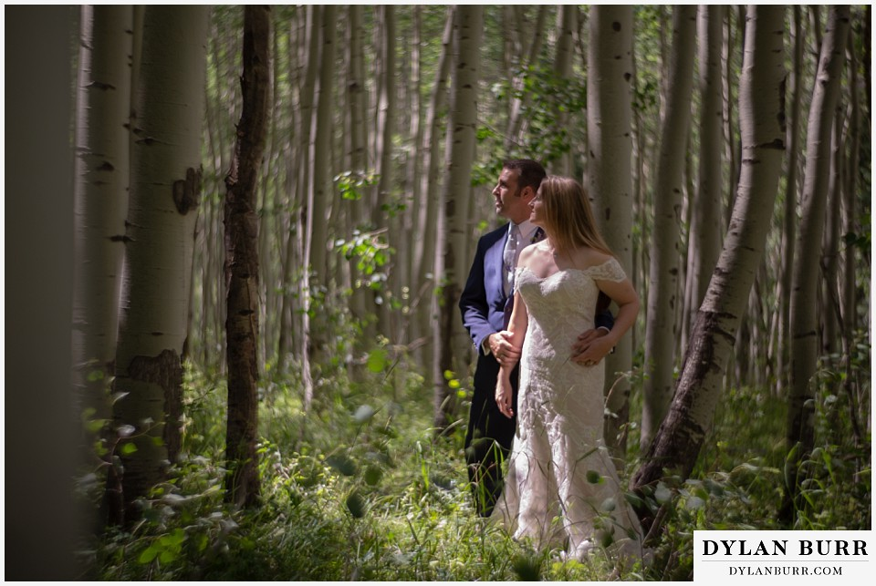 uncompahgre national forest colorado elopement wedding adventure bride and groom deep in aspen tree grove petzval lens