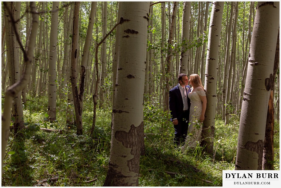 uncompahgre national forest colorado elopement wedding adventure bride and groom kissing in the aspen trees