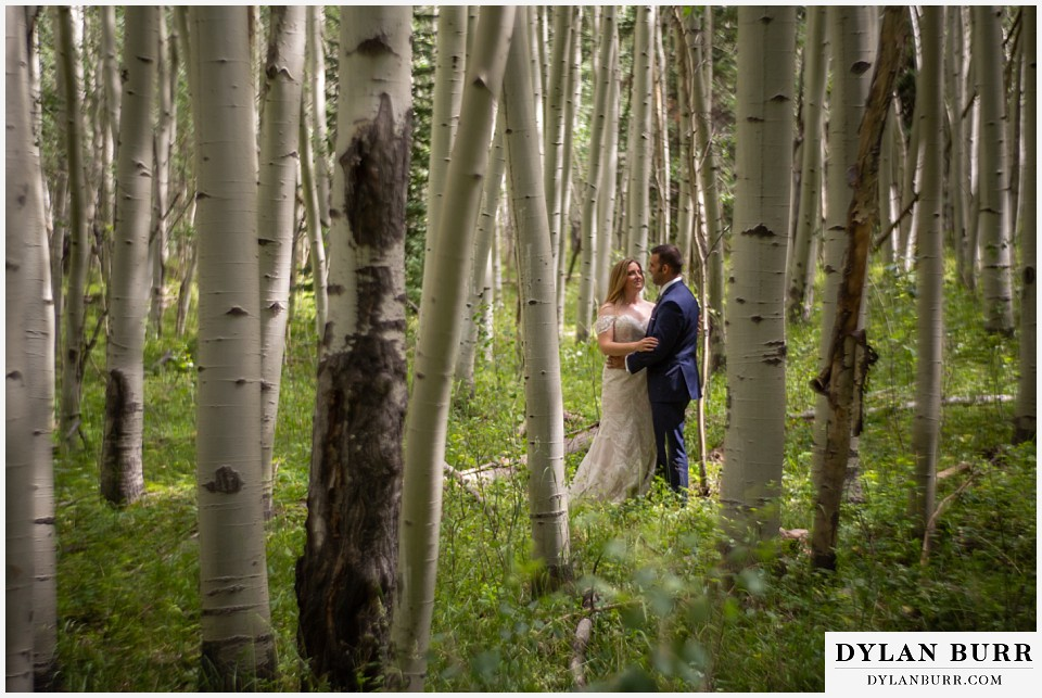 uncompahgre national forest colorado elopement wedding adventure bride and groom stading amoung the aspen trees