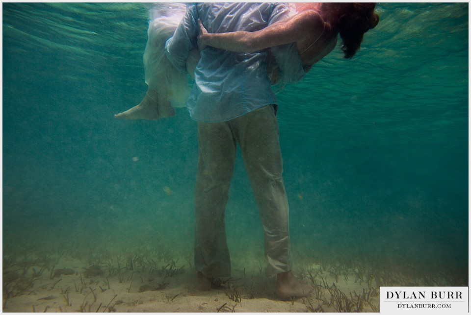 underwater wedding photography turks caicos carry wife