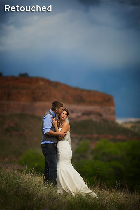 bride and groom together with red rock bluff mountains