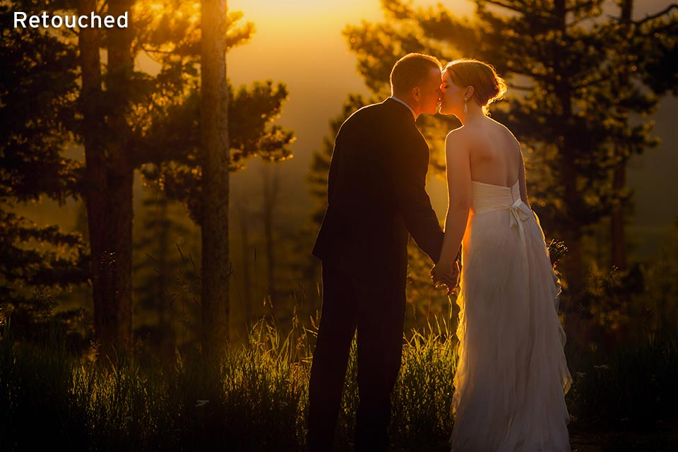 wedding couple standing together in mountains at sunset
