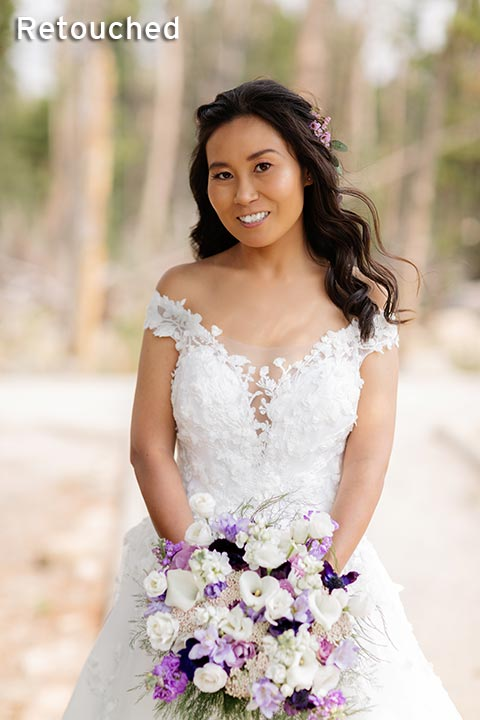 asian bride in mountains with bouquet