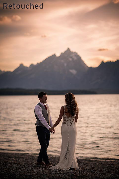bride and groom walking lakeside at sunset in grand teton national park wyoming