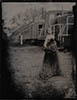 wedding tintype wet plate of bride in a black dress in a railyard outside boulder full of trains